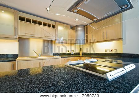 kitchen appliances with extractor fan and four ring hob