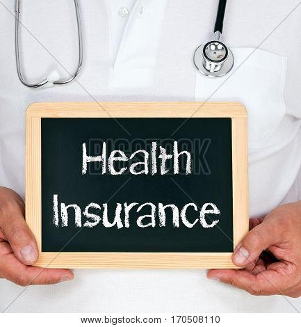 Health Insurance - Doctor holding chalkboard with text
