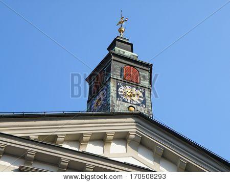 Stunning vintage clock tower under the sunny blue sky, Ljubljana, Slovenia