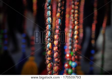 Colorful yarns hanging and beind arranged in a line