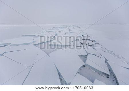 Lake Baikal cracks in ice. Ice floes. Winter landscape