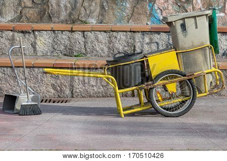 image of garbage trolley of street street sweeper