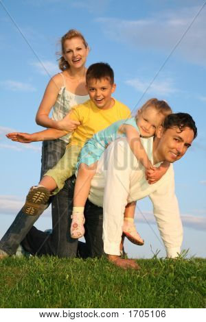 Playing Family On Grass