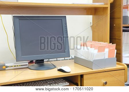 Computer monitor near the card index