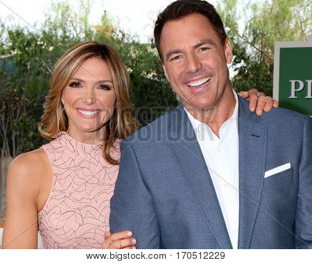 LOS ANGELES - JAN 5:  Debbie Matenopoulos, Mark Steines at the