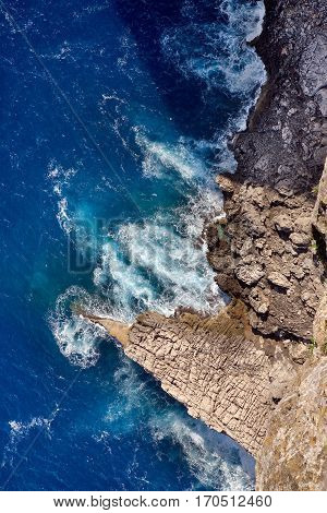 Free fall. Straight down to the rugged coastline from the viewpoint to Formentor Point in Mallorca, Spain