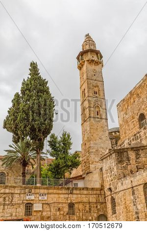 Omer mosque minaret in front of the Church of the Holy Sepulchre in Jerusalem, Israel.
