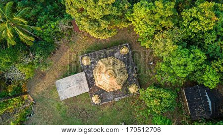 Top aerial view of a gilded pagoda on a hill, Myanmar