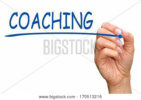 Coaching - female hand with blue marker writing text on white background