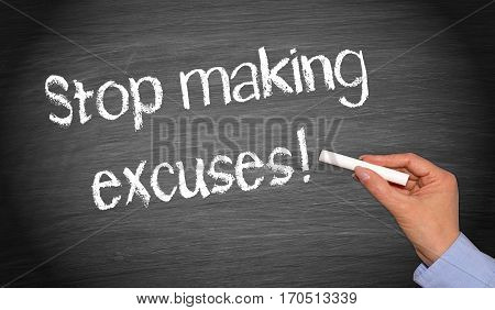 Stop making excuses - hand writing text on blackboard