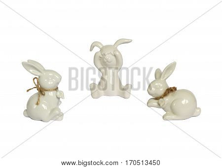 Funny rabbits ceramic with Easter eggs decorated with daisies on wooden background