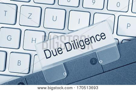 Due Diligence - folder with text on computer keyboard