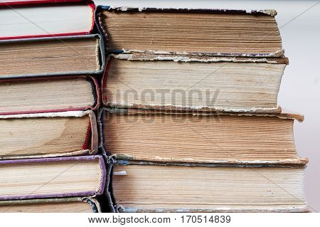 Stack of hardback books close-up. Back to school. Copy space.