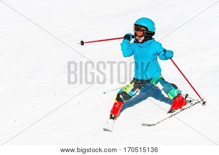 Cute little child skiing down the, toned image, outdoors
