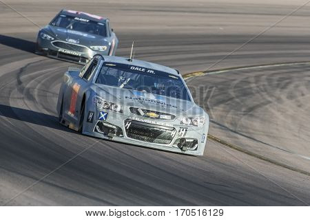 January 31, 2017 - Avondale, Arizona, USA:  Dale Earnhardt, Jr. takes his Hendrick Motorsports Chevrolet through the turns during a practice at the Phoenix Test at Phoenix Raceway in Avondale, AZ.