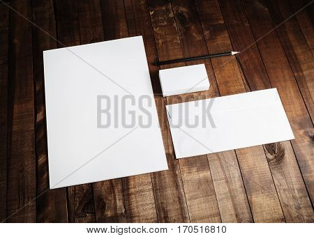 Mockup business template. Blank stationery set on wooden table background. ID template. Mock up for branding identity for designers. Blank letterhead business cards envelope and pencil.
