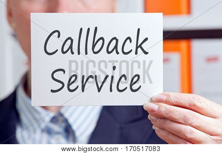 Callback Service - woman with sign in the office