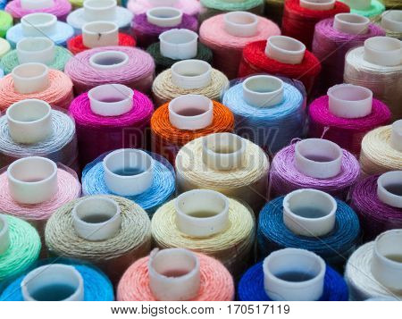 Hanks of multi-coloured threads and hanks for embroidery.