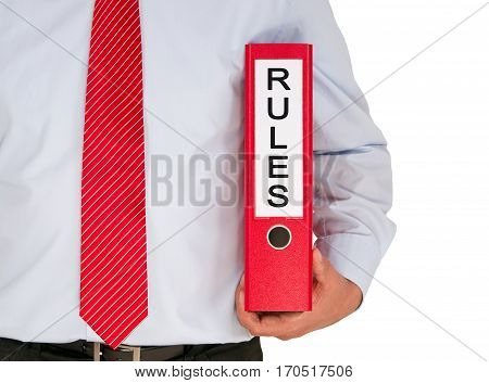 Rules - Businessman holding binder with text on white background