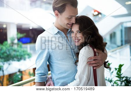 Young couple hugging in a shopping mall