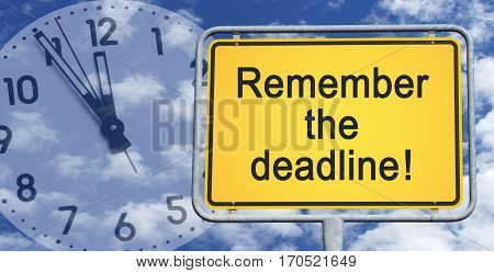 Remember the deadline - yellow traffic sign with text and clock in the background