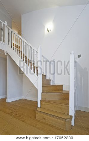 split level living room with wooden stair case