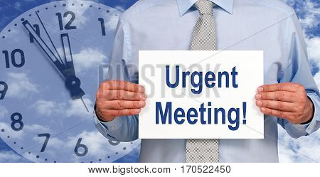 Urgent Meeting - Businessman with sign and clock in the background