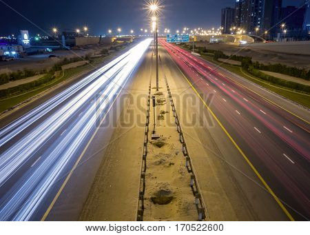 Highway colorful light trails and street lights, taken from the bridge in Dubai, UAE.