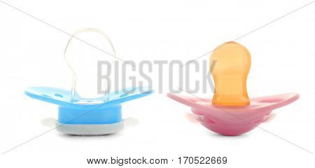Baby pacifiers on white background