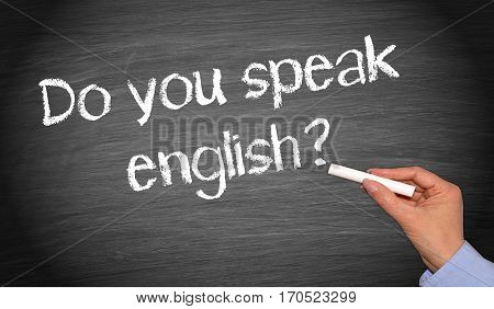 Do you speak english? Chalkboard with female hand and text