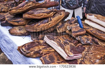 Domestic smoked bacon and other traditional smoked products exposed to sale.