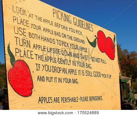 Picking guidelines sign for autumn apple orchards