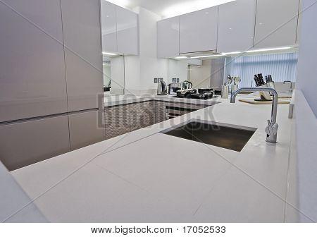 modern kitchen with white sand stone worktop