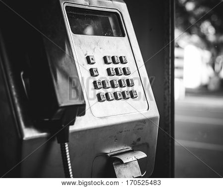 Payphone in phone box black and white