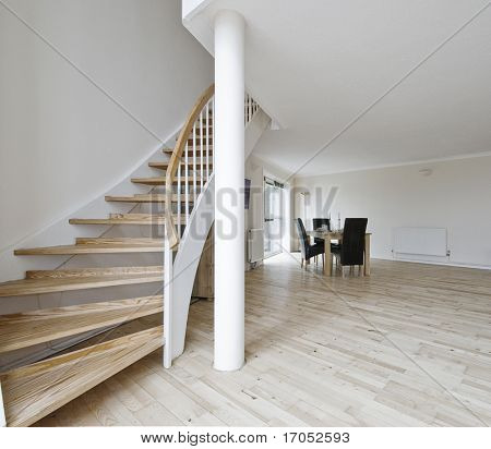 open plan living room of a duplex apartment with staircase