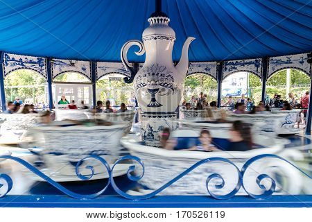 Garda Italy - September 8 2015: Merry-go-round with giant cups that rotate whirling.