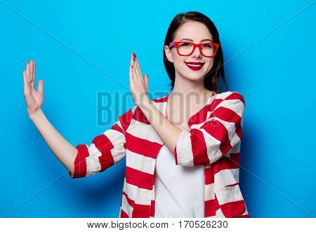 Portrait Of The Beautiful Young Smiling Woman On The Blue Background