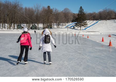 Montreal, Ca - 31 January 2017: People Skating On Beaver Lake Skating Rink On Mount-royal
