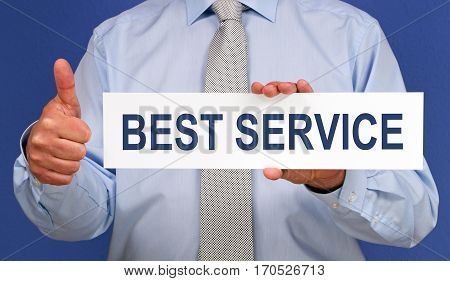 Best Service - Businessman holding sign with text on blue background