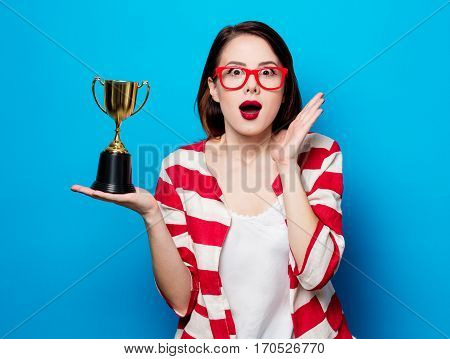 Young Surprised Woman With Cup Trophy