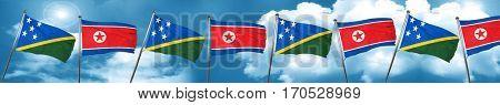 Solomon islands flag with North Korea flag, 3D rendering