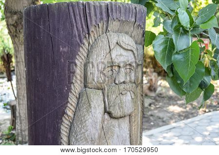 Wooden Idol. Woodcarving. Decoration Of The Park In The Form Of