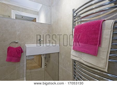 contemporary bathroom with towel rail and pink towels