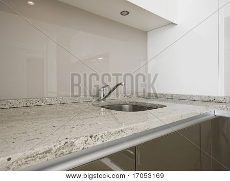 modern kitchen counter closeup with granite worktop
