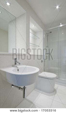 modern en-suite bathroom with glass slide door shower cabin