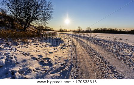 Winter landscape at sunset and road. Moravian landscape Chrudichromy.