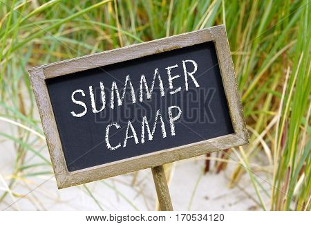 Summer Camp - chalkboard with text and beach in the background