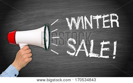 Winter Sale - female hand with megaphone