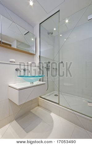 luxury designer en-suite bathroom with glass bowl like hand wash basin