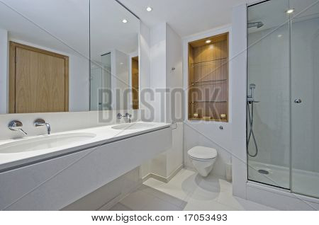 luxury en-suite bathroom with dual hand wash basin